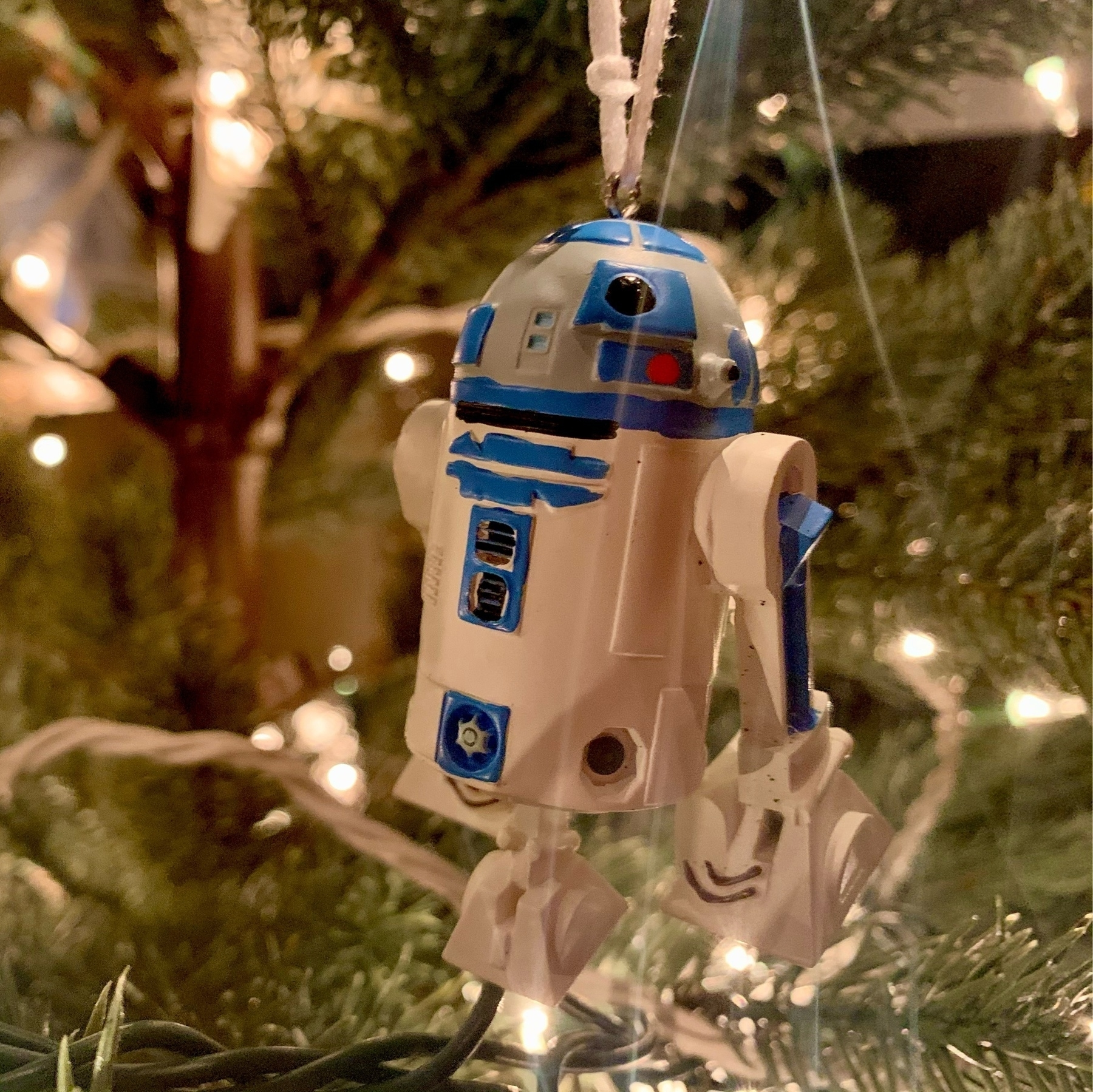 R2-D2 christmas ornament hung on tree